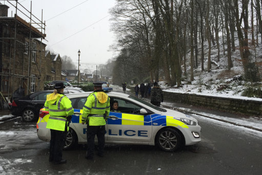 "A general view of police near the scene after mother-of-three Sadie Hartley, 60, was murdered in a ""ferocious"" knife attack at her £450,000 home in the village of Helmshore, Lancashire."