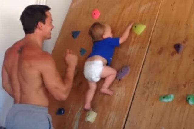 baby climbing rock wall