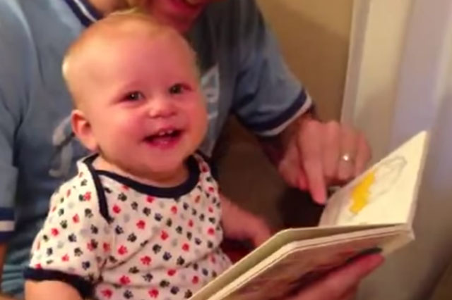 This baby really loves reading! (Video)