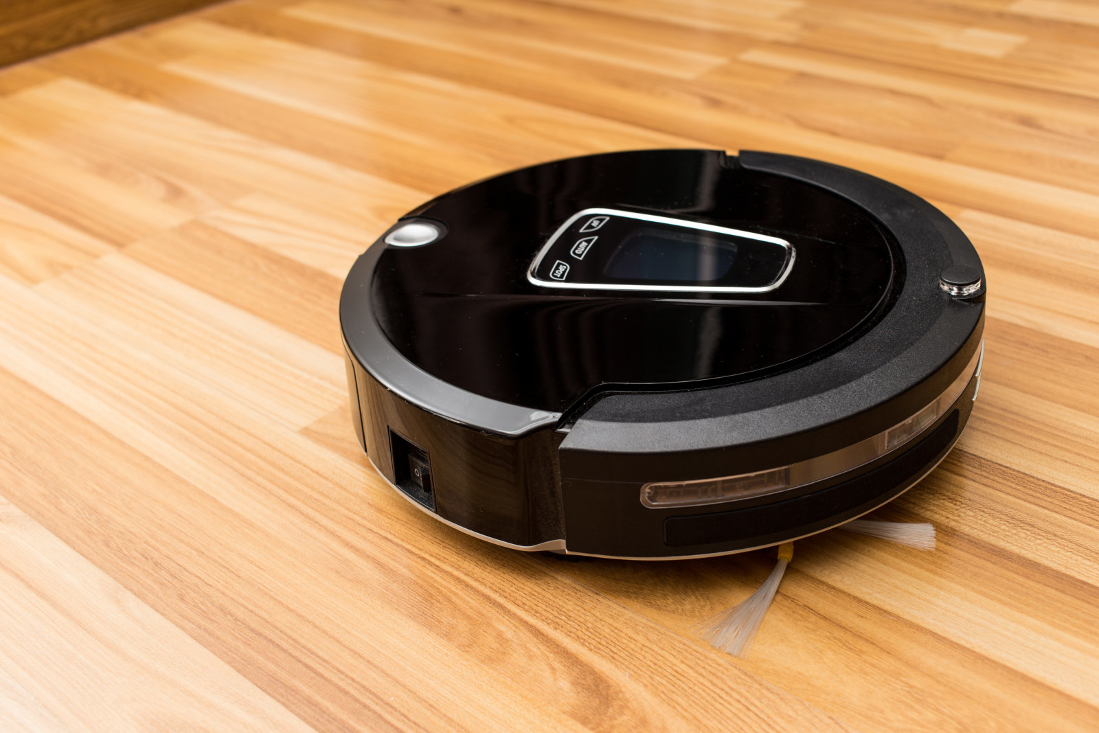 Robotic vacuum cleaner on wood parquet floor, Smart vacuum, new automate technology housework.Robotic vacuum cleaner on wood parquet floor, Smart vacuum, new automate technology housework.Robotic vacuum cleaner on wood parquet floor, Smart vacuum, new automate technology housework.
