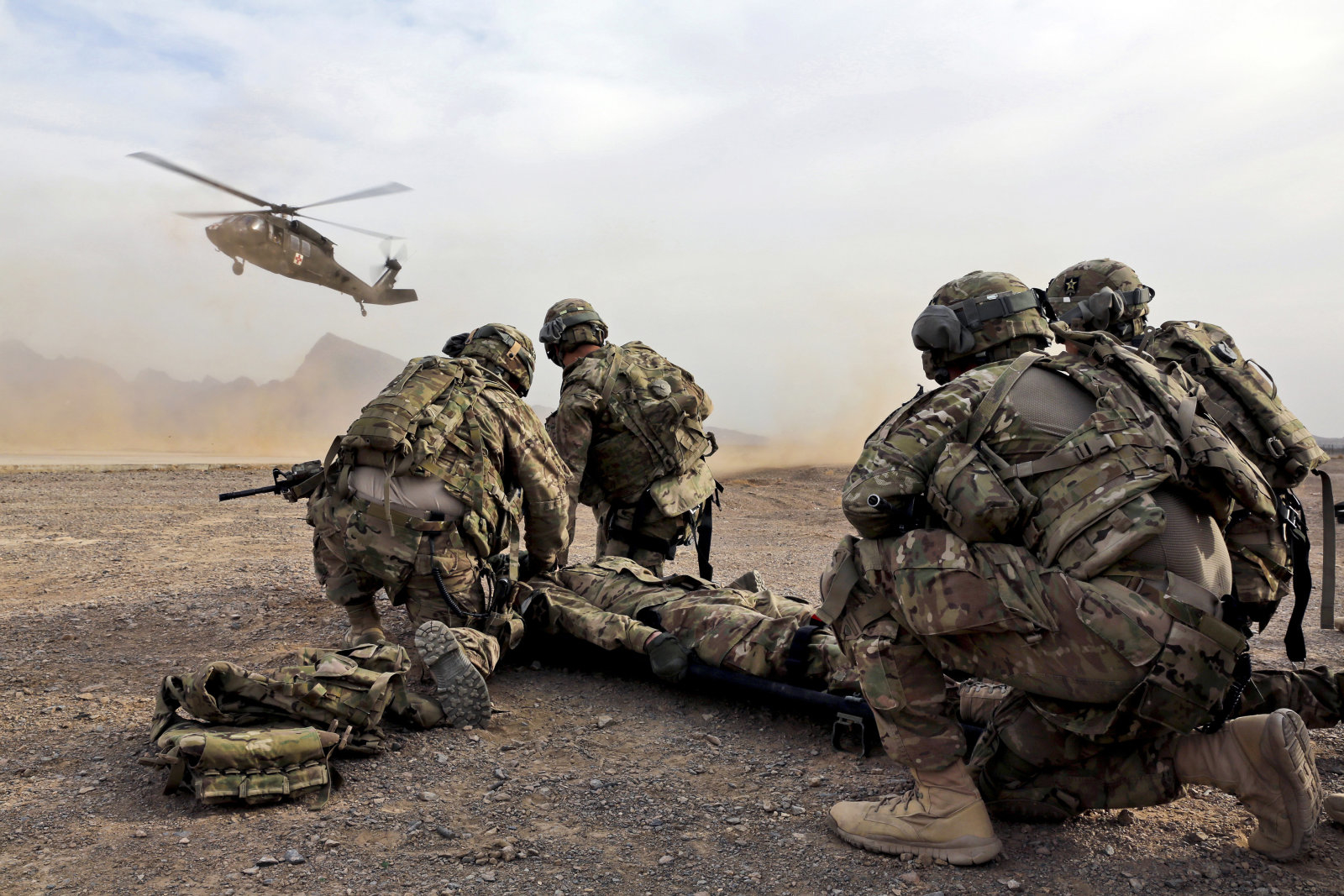 January 9, 2013 - Security force team members for Provincial Reconstruction Team (PRT) Farah wait for a UH-60 Blackhawk medevac helicopter to land before moving a simulated casualty during medical evacuation training on FOB Farah, Afghanistan. =