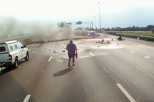 Hero truck driver pulls grandmother and baby from burning car (Video)