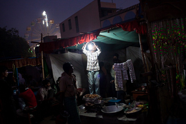 An Indian street vendor gets a light bulb going