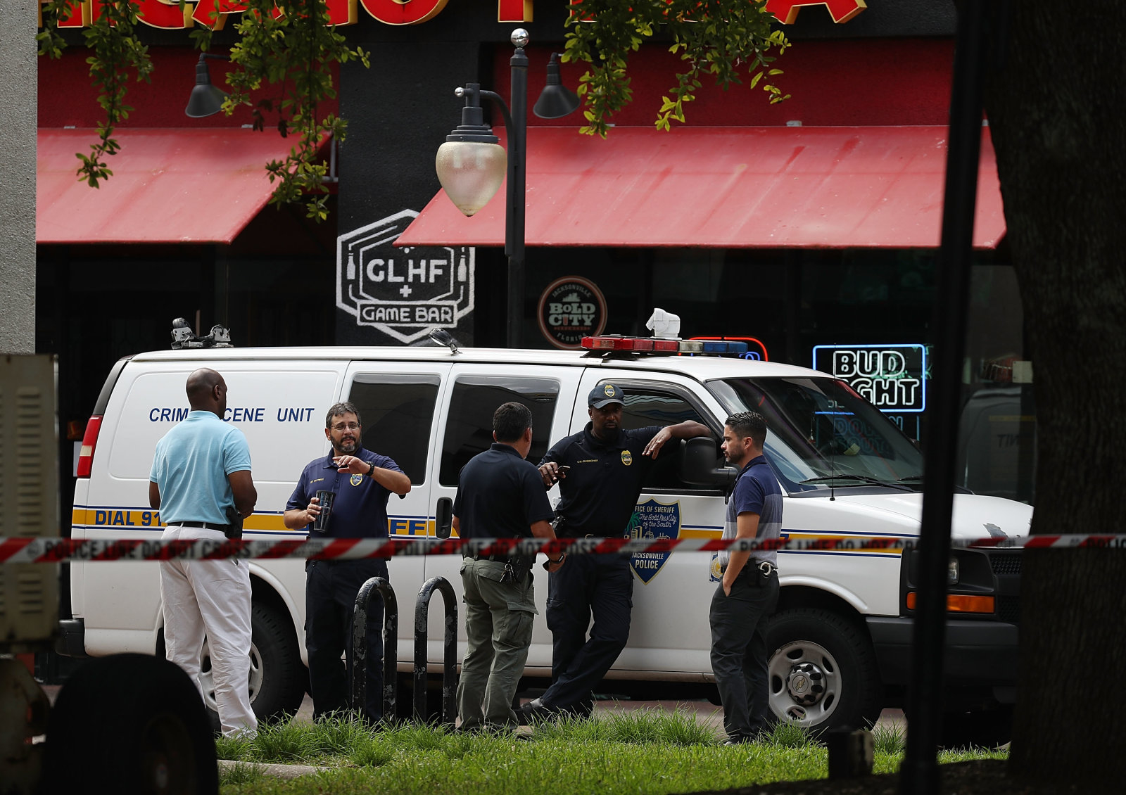 JACKSONVILLE, FL - AUGUST 27:  Law enforcement officials investigate a shooting in the GLHF Game Bar where 3 people including the gunman were killed at the Jacksonville Landing on August 27, 2018 in Jacksonville, Florida. The shooting occurred during a Madden 19 video game tournament and initial reports indicate 3 people were killed including the gunman, with several others wounded.  (Photo by Joe Raedle/Getty Images)