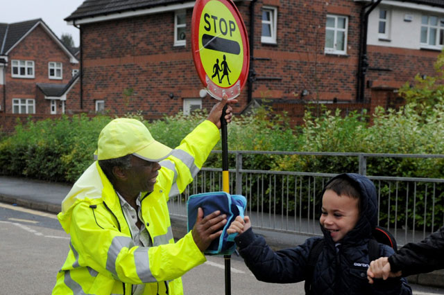 Scotland's 'happiest lollipop man' banned from high-fiving children