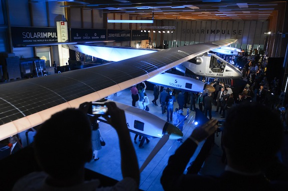 Visitors walk under the new experimental aircraft
