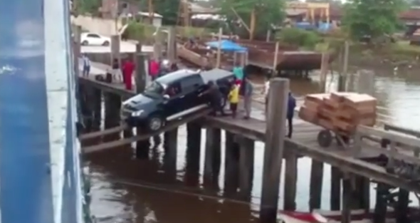 Truck driver boards ferry over plank 'bridge' (video)