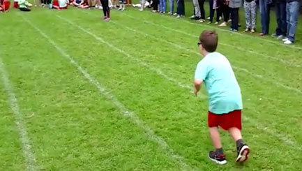 Kids' touching sports day gesture to classmate