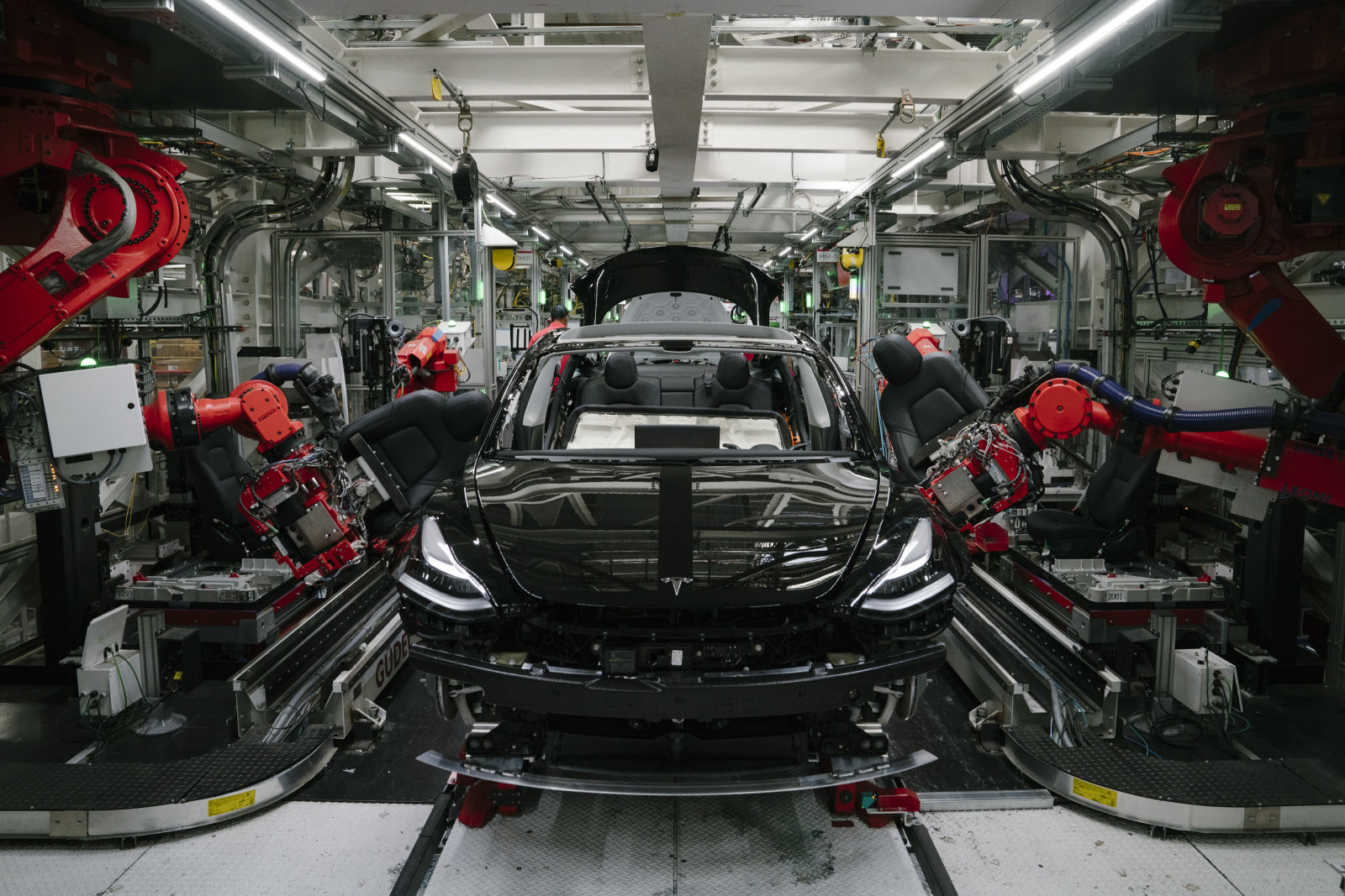 FREMONT, CA - JULY 26: Robotics arms install the front seats to the Tesla Model 3 at the Tesla factory in Fremont, California, on Thursday, July 26, 2018. (Photo by Mason Trinca for The Washington Post via Getty Images)