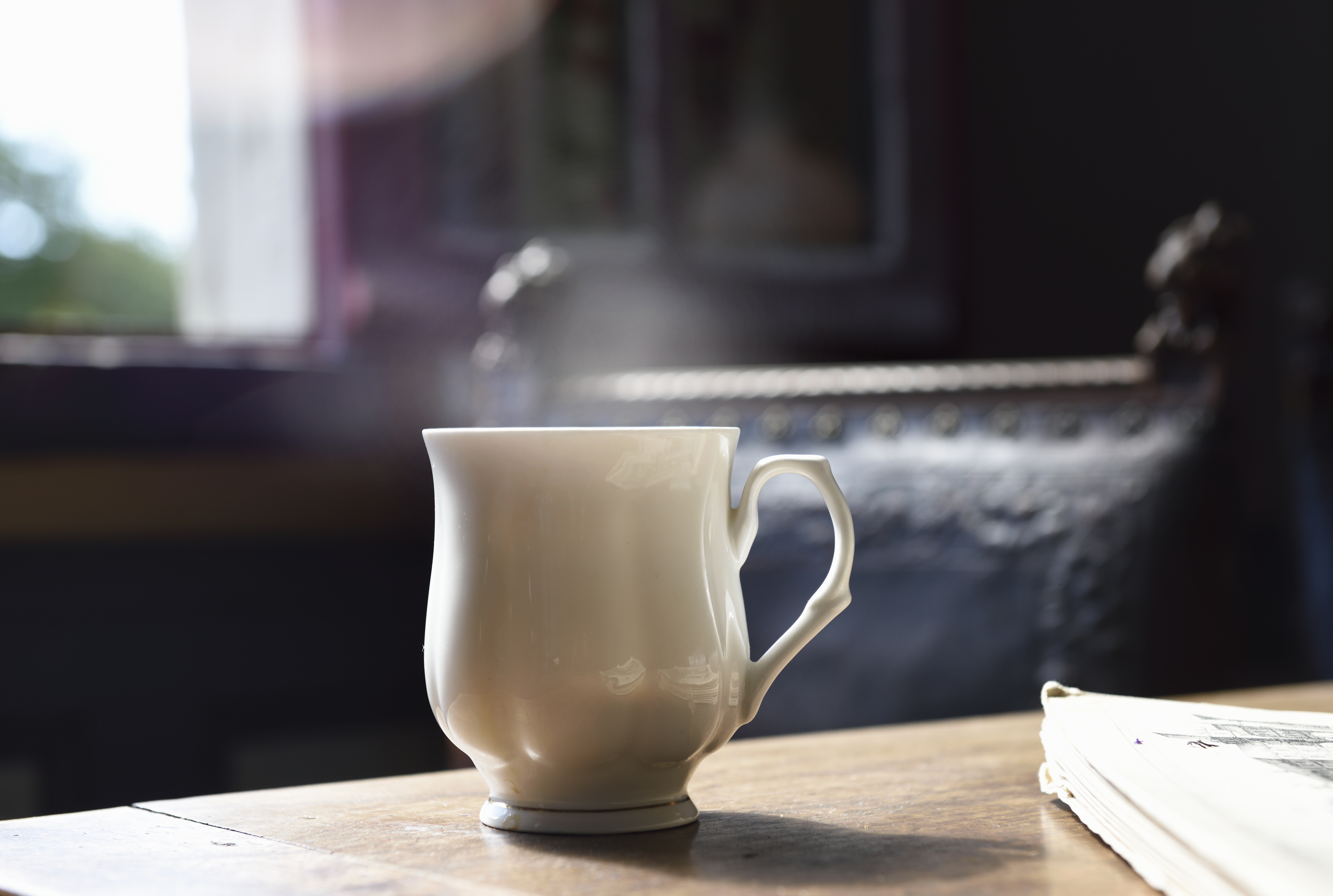 cup of tea on table with steam