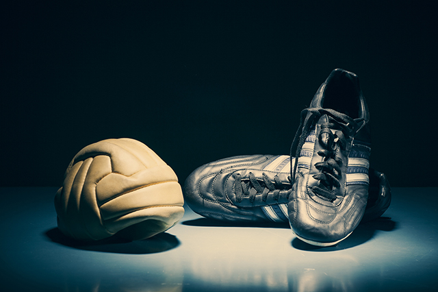Soccer shoe and old  ball