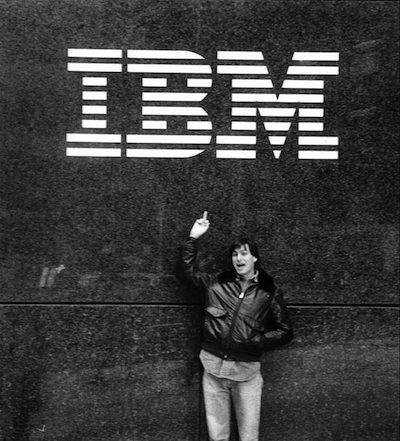 Steve Jobs flips off the IBM logo in