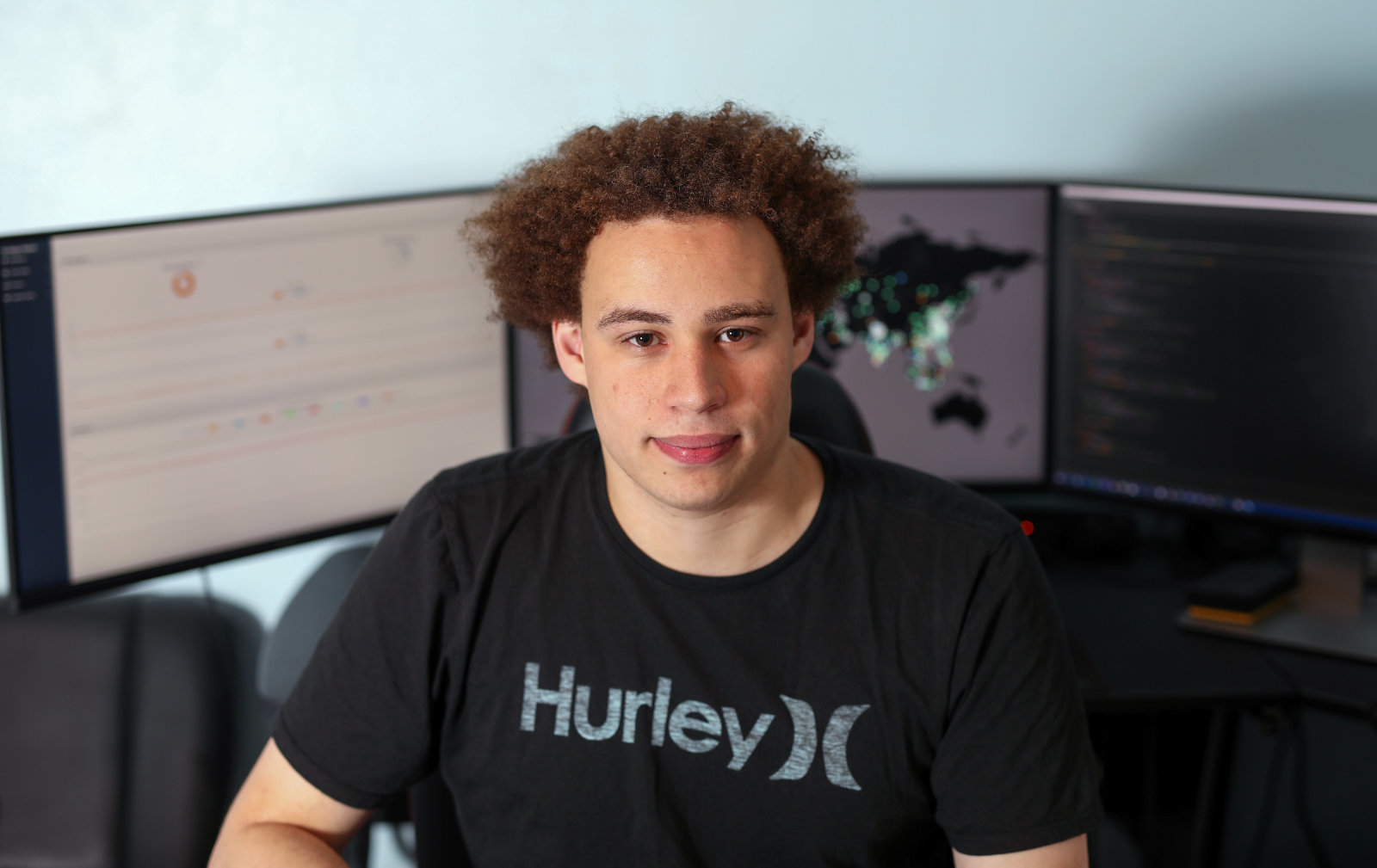 Marcus Hutchins, digital security researcher for Kryptos Logic, poses for a photograph in front of his computer in his bedroom in Ilfracombe, U.K., on Tuesday, July 4, 2017. Hutchins, the 23-year-old who saved the world from a devastating cyberattack in May was asleep in his bed in the English seaside town of Ilfracombe last week after a night of partying when another online extortion campaign spread across the globe. Photographer: Chris Ratcliffe/Bloomberg via Getty Images