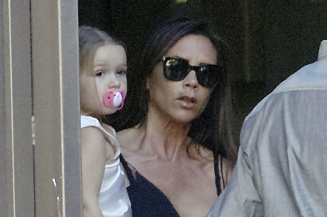 Victoria and David Beckham's daughter Harper photographed sucking a dummy at the age of three