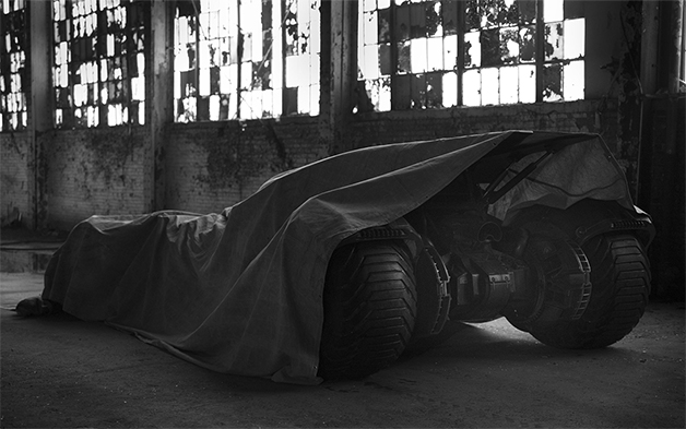 A teased view of the new Batmobile that will appear in the movie Batman vs. Superman, directed by Zack Snyder.