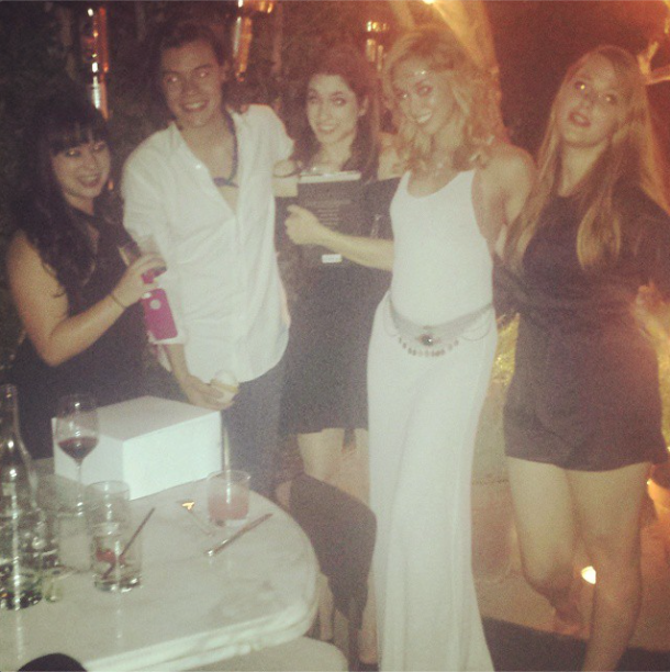 harry styles pays girls bar tab smashes cupcake in face