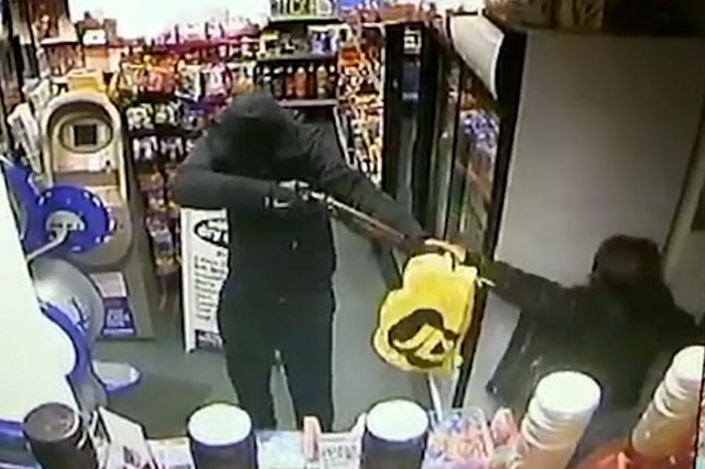 Mum protects daughter, 7, from armed robber