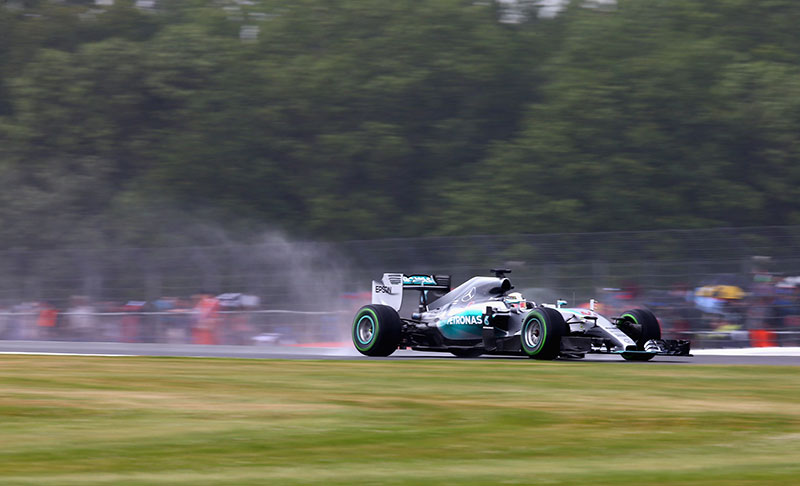 Lewis Hamilton drives in the wet at the 2015 British Grand Prix.