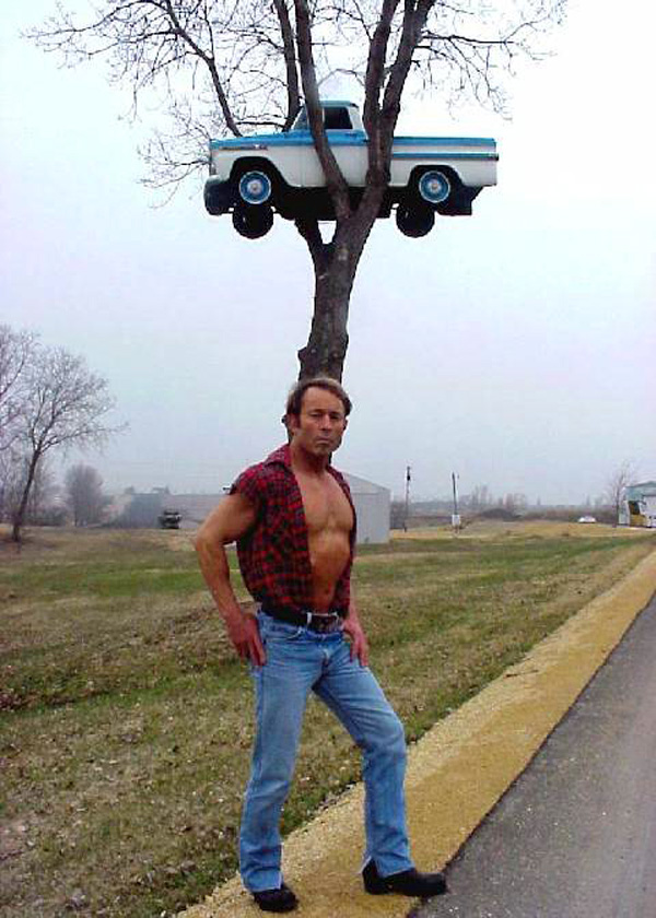 manliest photos on the internet, funny manly images, pickup truck stuck in tree