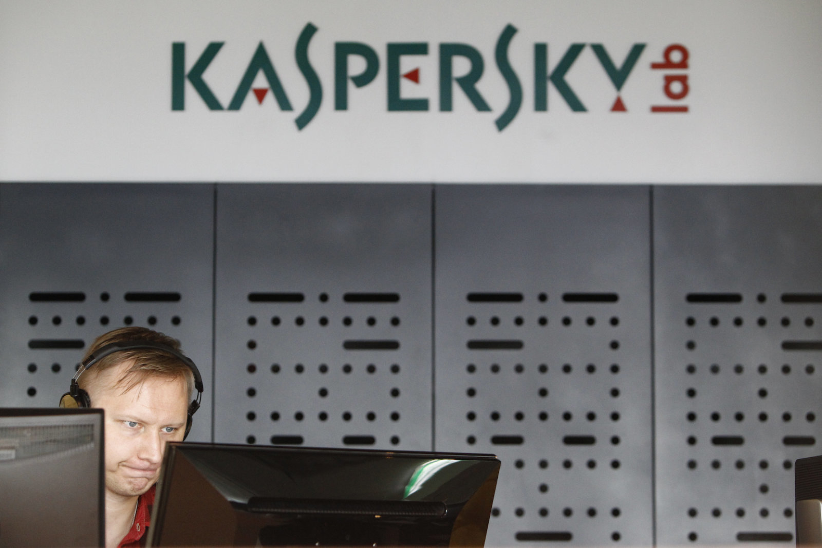 An employee works near screens in the virus lab at the headquarters of Russian cyber security company Kaspersky Labs in Moscow July 29, 2013. If you want to hack a phone, order a cyber attack on a competitor's website or buy a Trojan programme to steal banking information, look no further than the former Soviet Union. Picture taken July 29, 2013. To match Feature RUSSIA-CYBERCRIME/  REUTERS/Sergei Karpukhin (RUSSIA - Tags: SCIENCE TECHNOLOGY CRIME LAW BUSINESS)