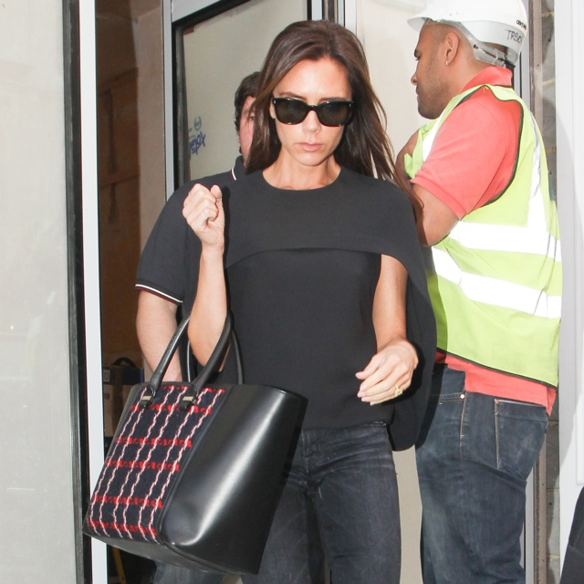 Victoria Beckham works cape as she visits flagship London store
