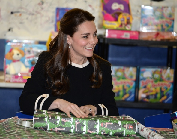 Kate Middleton rolls eyes after being told to 'keep wrapping' at children's charity event