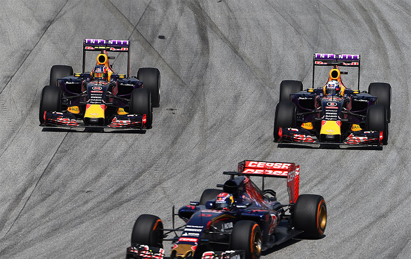 A Toro Rosso ahead of two Red Bulls at the 2015 Malaysian F1 Grand Prix.
