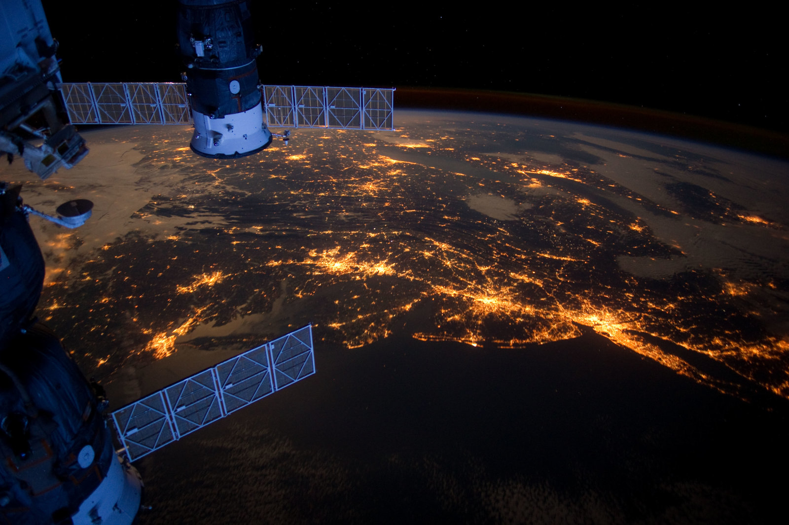 SPACE - FEBRUARY 6: The Atlantic coast of the United States taken at night from the International Space Station on February 6, 2012 in Space. An Expedition 30 crew member aboard the International Space Station took this night time photograph of much of the Atlantic coast of the United States. Large metropolitan areas and other easily recognizable sites from the Virginia/Maryland/Washington, D.C. area are visible in the image that spans almost to Rhode Island. Boston is just out of frame at right. Long Island and the New York City area are visible in the lower right quadrant. Philadelphia and Pittsburgh are near the center. Parts of two Russian vehicles parked at the orbital outpost are seen in left foreground. PHOTOGRAPH BY NASA / Barcroft Media /Barcoft Media via Getty Images