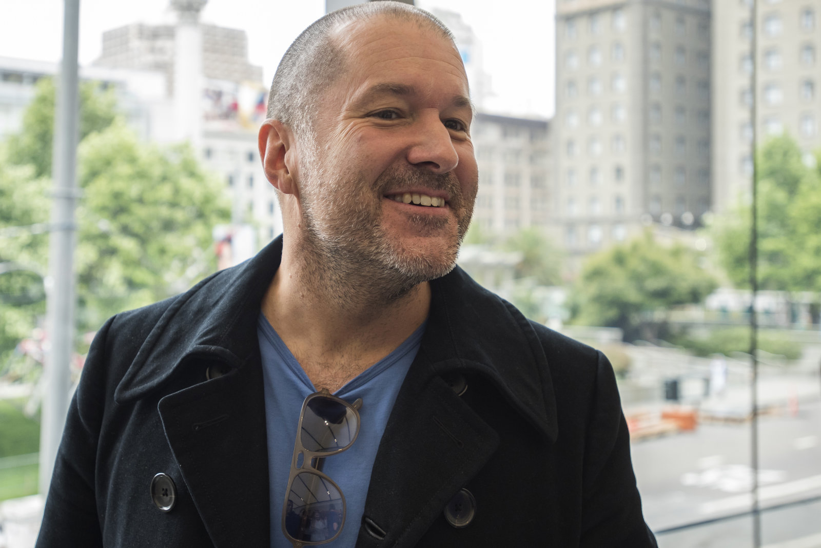 """Jonathan """"Jony"""" Ive, chief design officer for Apple Inc., speaks with attendees during the grand opening of the company's new flagship store at Union Square in San Francisco, California, U.S., on Saturday, May 21, 2016. The flagship location boasts 40-foot-tall doors opening onto the square and comprises five departments, or what Apple prefers to call """"features."""" Photographer: David Paul Morris/Bloomberg via Getty Images"""