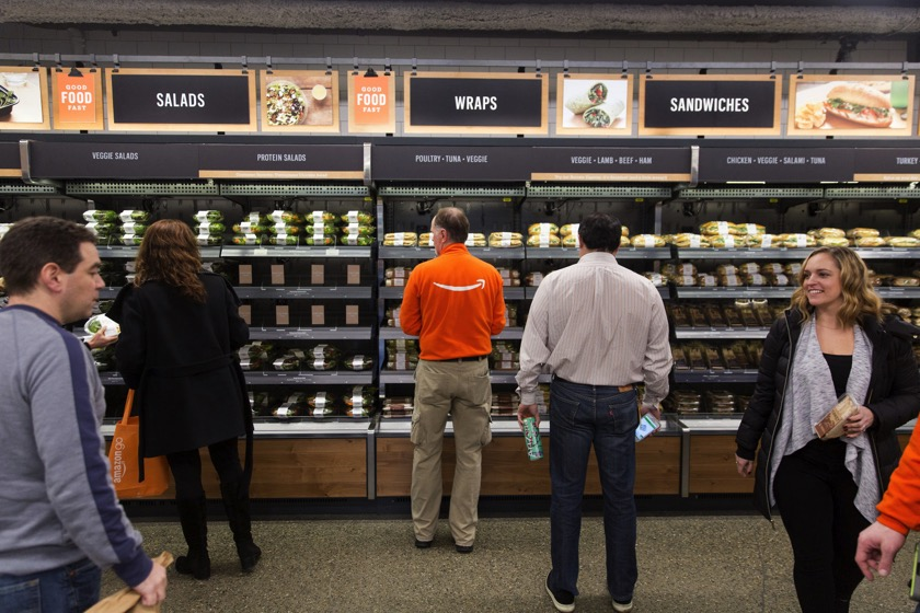 Amazon.com Inc. employees shop at the Amazon Go store in Seattle, Washington, U.S., on Wednesday, Jan. 17, 2018. After more than a year of testing with an employee-only focus group, Amazon Go opens to the public Monday in downtown Seattle, putting to the test the online retailer's technology that lets shoppers grab what they want and leave without paying a cashier. Photographer: Mike Kane/Bloomberg