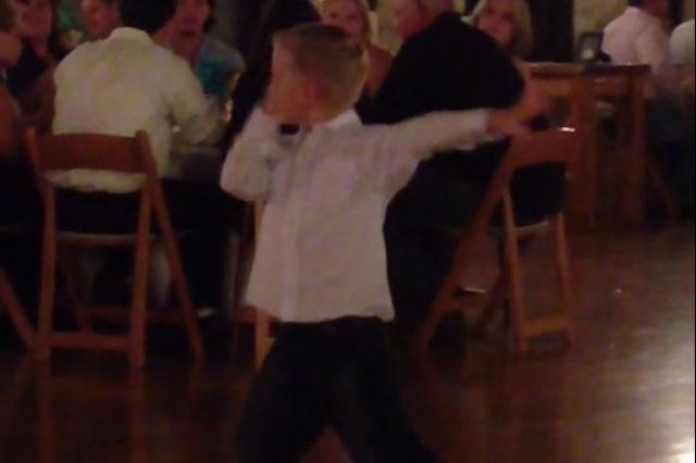 boy dancing at wedding