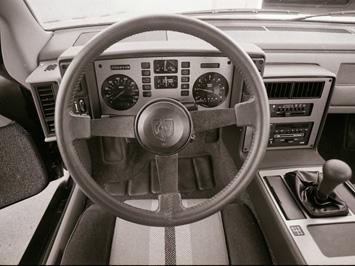 This Or That 2005 Chrysler Crossfire Srt6 Vs 1984 Pontiac Fiero Autoblog