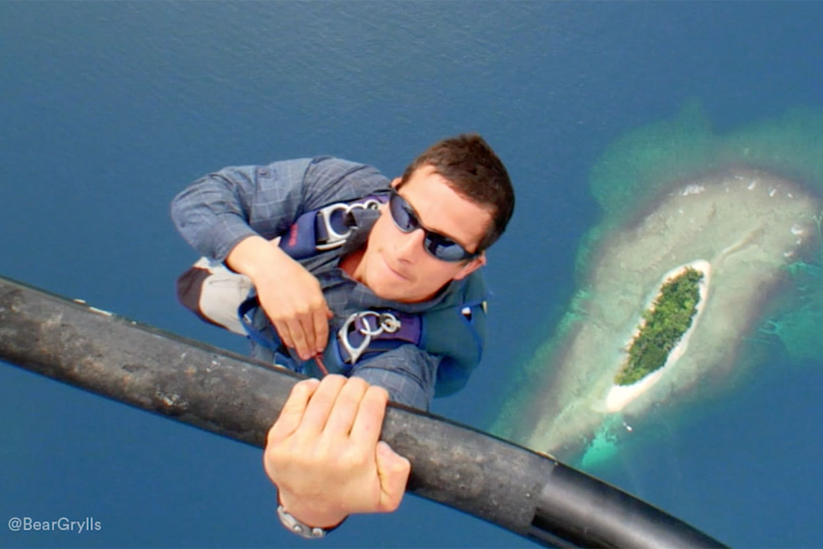 manliest photos on the internet, funny manly images, bear grylls holding helicopter