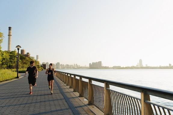 Jogging couple running along riverside