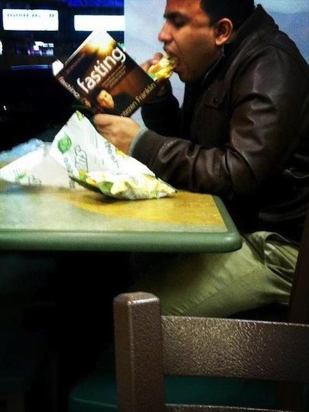 funny ironic photos, irony photos, eating man reading fasting book