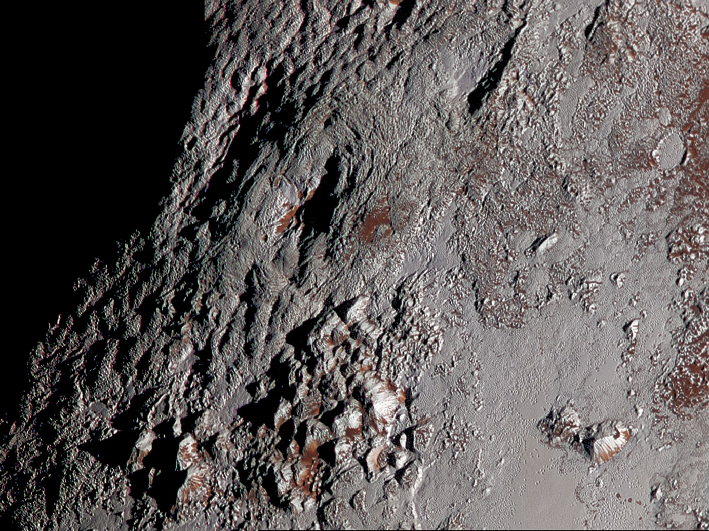 Pluto probe sends back photos of possible ice volcano