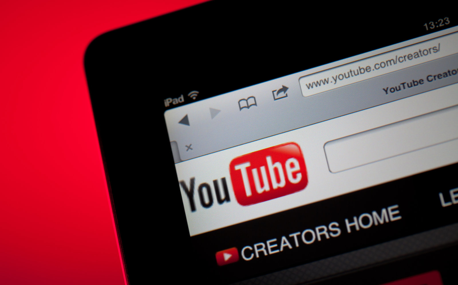 Ankara, Turkey - October 11, 2011:  Close up view of the YouTube home screen.The iPad is produced by Apple Computer, Inc.