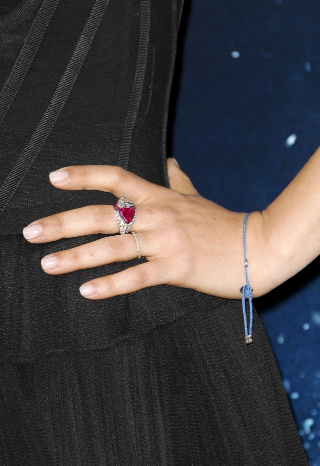 Mila Kunis wows at Jupiter Ascending premiere and shows off 'wedding' ring