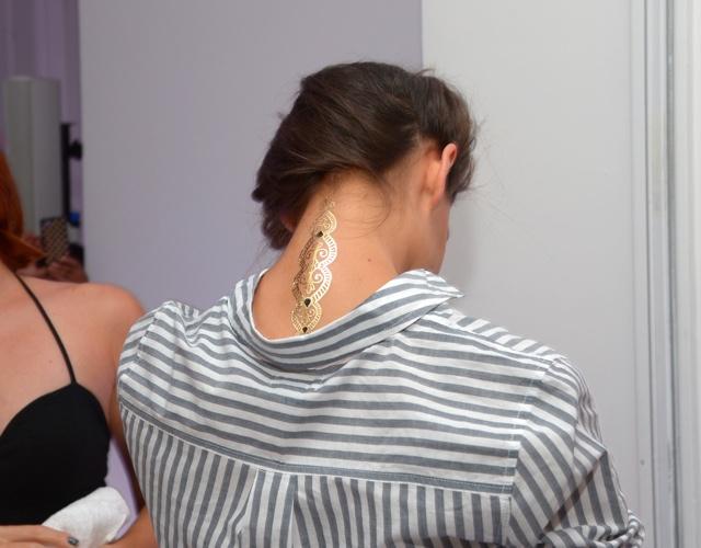 Katie Holmes gets a tattoo at New York Fashion Week