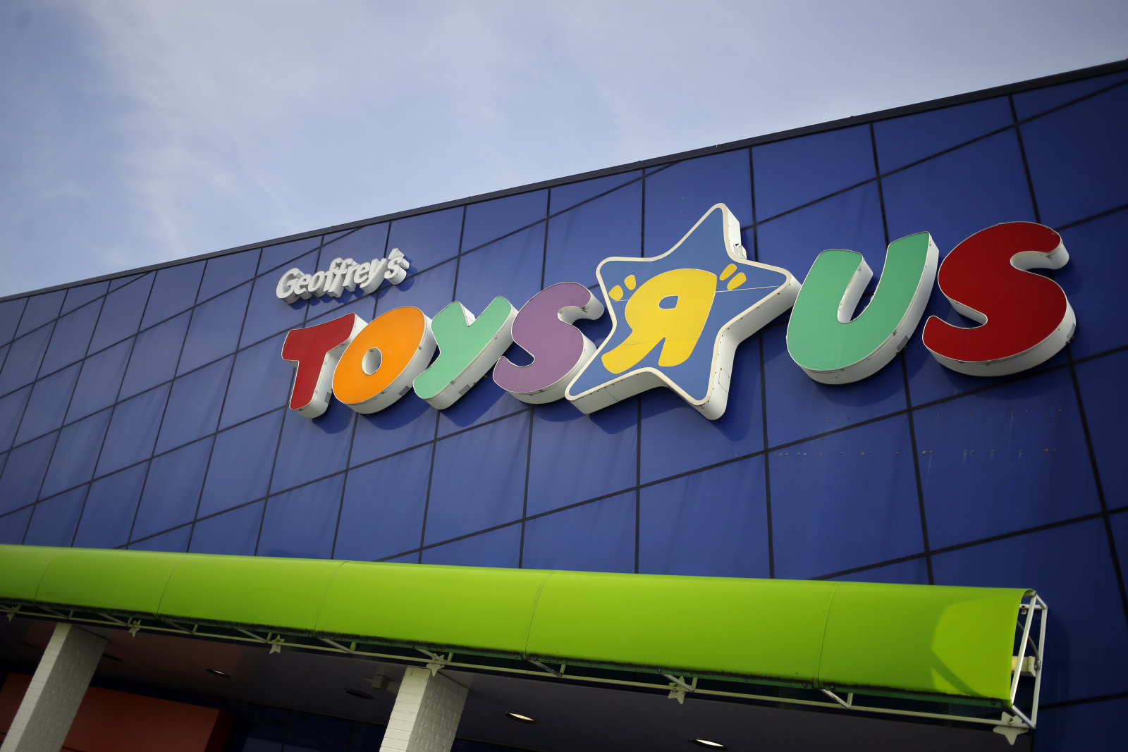 Signage is displayed outside a Toys R Us Inc. retail store in Louisville, Kentucky, U.S., on Monday, Sept. 18, 2017. Toys R Us Inc., which has struggled to lift its fortunes since a buyout loaded the retailer with debt more than a decade ago, is preparing a bankruptcy filing as soon as today, according to people familiar with the situation. Photographer: Luke Sharrett/Bloomberg via Getty Images