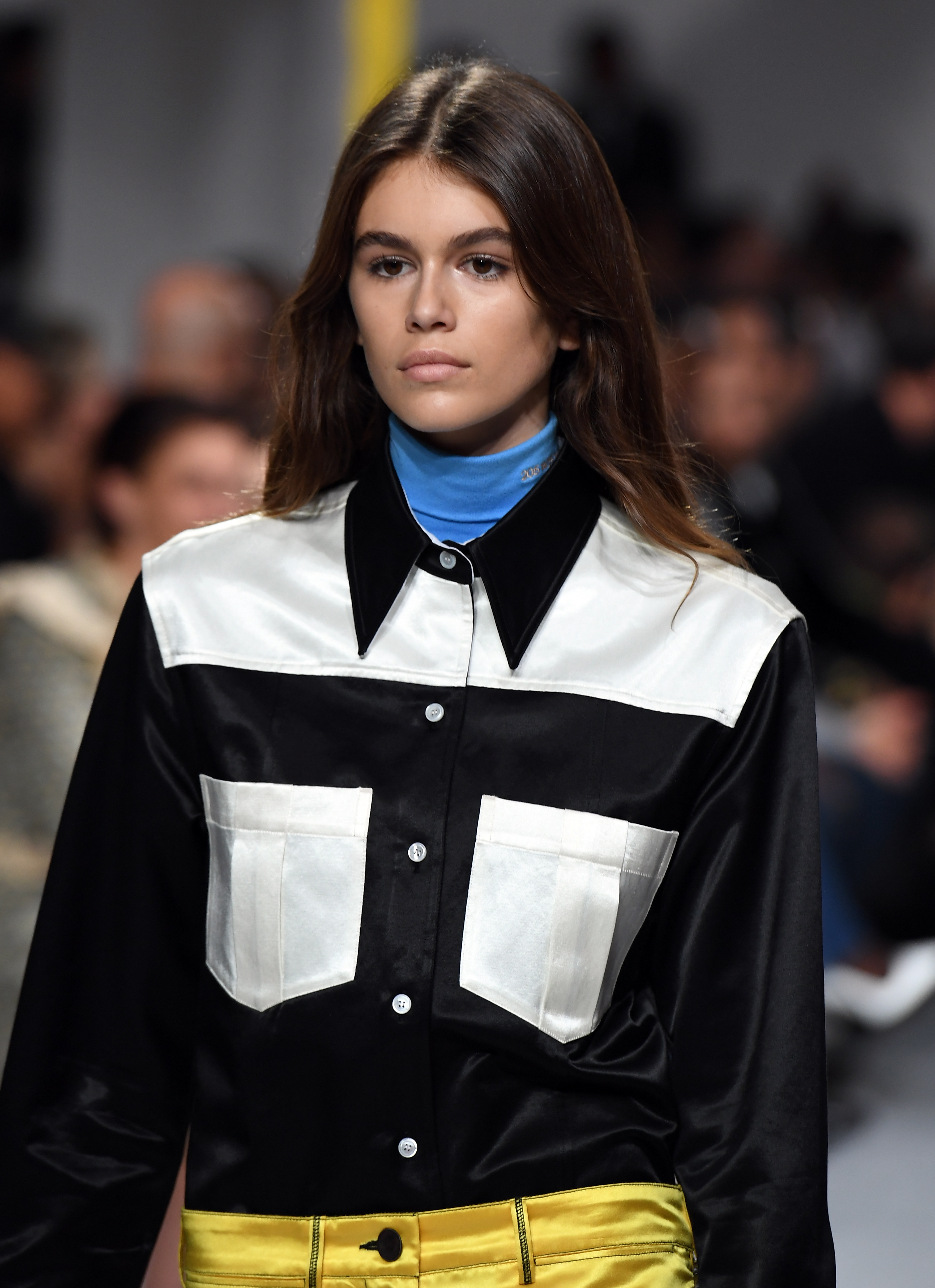 Model Kaia Gerber sports a lustrous beauty look at Calvin Klein Collection.