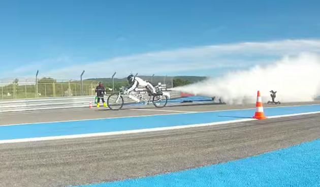 Francois Gissy rides his rocket-powered bike