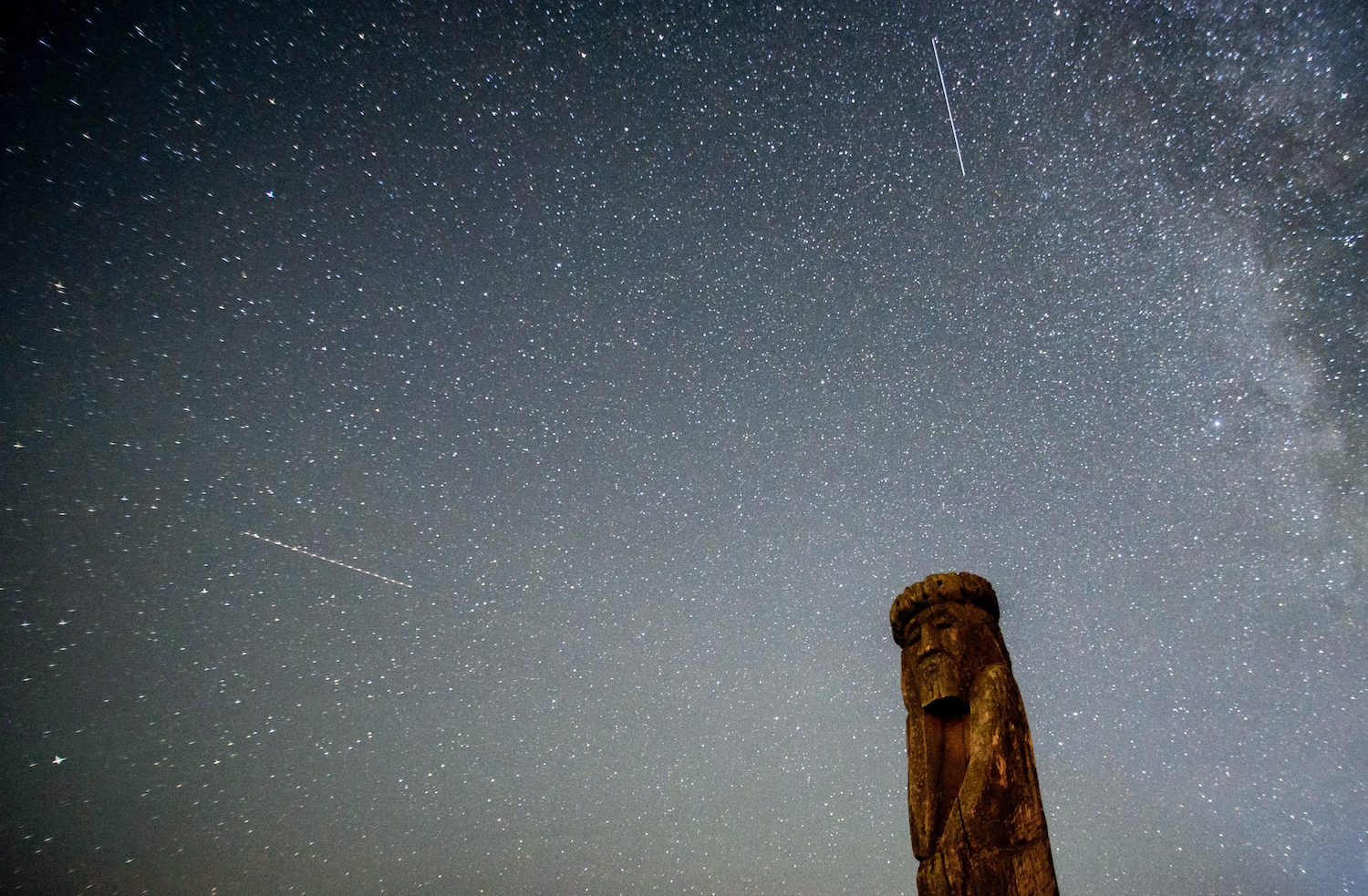 Shooting stars cross the night sky over a wooden idol near the village of Ptich some 25km away from Minsk, during the peak of the annual Perseid meteor shower on August 15, 2015. The Perseid meteor shower occurs every year when the earth passes through the cloud of debris left by Comet Swift-Tuttle. The showers are named after the constellation of Perseus, the hero from Greek mythology who beheaded the snake-headed Medusa to save the princess Andromeda. AFP PHOTO / SERGEY BALAY