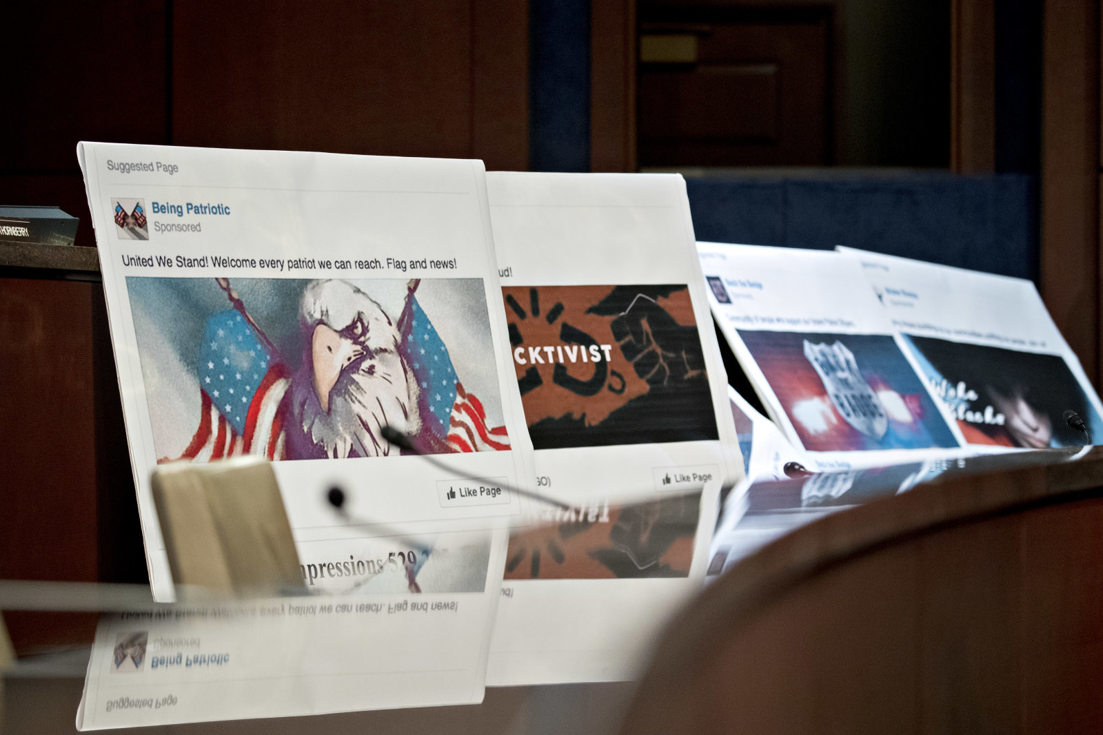 Displays showing social media posts are seen during a House Intelligence Committee hearing in Washington, D.C., U.S., on Wednesday, Nov. 1, 2017. The top Democrat on the Senate Intelligence Committee berated lawyers today for social media giants Facebook, Twitter and Google for a lethargic response to Russian interference in U.S. politics, as the companies' lawyers faced a second day of grilling in Congress. Photographer: Andrew Harrer/Bloomberg via Getty Images