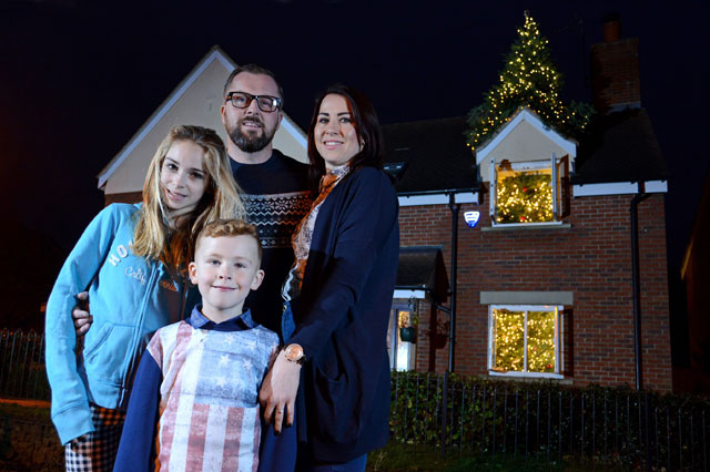 Family given 25ft Christmas tree which bursts through the roof - one year after burglars stole their presents