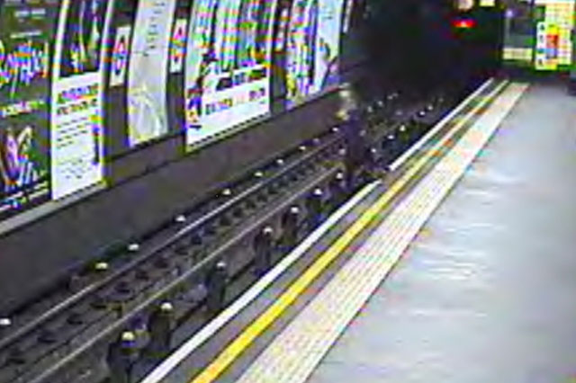 CCTV captures terrifying moment a child in a buggy is blown onto Tube tracks - seconds before train arrives