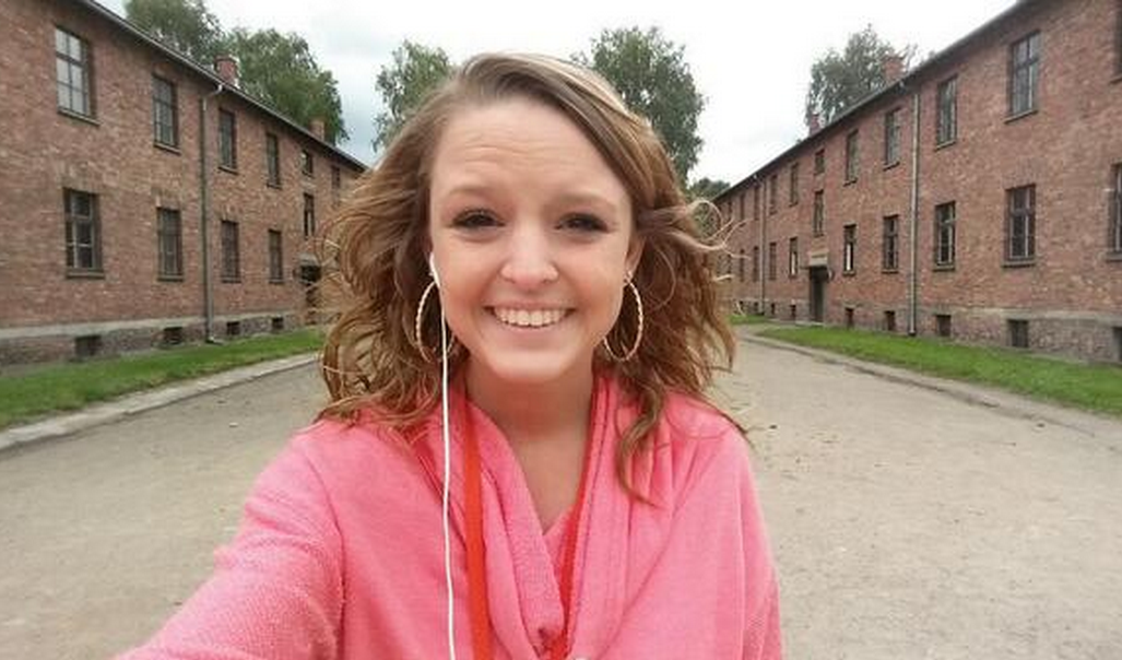 Breanna Mitchell takes a selfie at Auschwitz Concentration Camp.