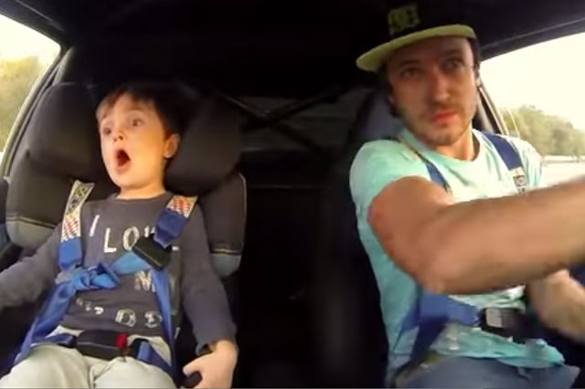 Son's hilarious reaction to dad's crazy driving (video)