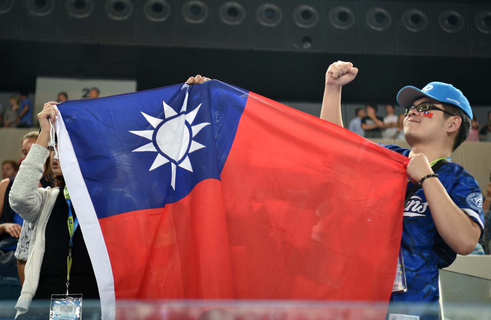 Fans of Taiwan's Hsieh Su-Wei hold the Taiwan flag after she beat Poland's Agnieszka Radwanska in their women's singles third round match on day six of the Australian Open tennis tournament in Melbourne on January 20, 2018. / AFP PHOTO / PETER PARKS / -- IMAGE RESTRICTED TO EDITORIAL USE - STRICTLY NO COMMERCIAL USE --        (Photo credit should read PETER PARKS/AFP/Getty Images)