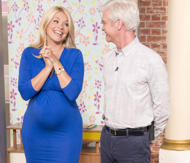 Pregnant Holly Willoughby shows off her bump in blue ...